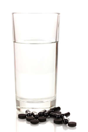 glass of water and activated carbon isolated on white photo