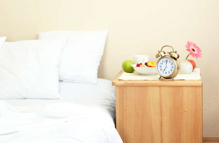 light breakfast on the nightstand next to the bed Stock Photo - 15830635