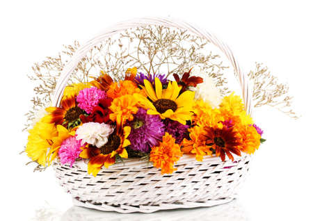 Beautiful bouquet of bright flowers in white basket isolated on white photo