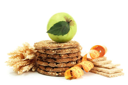 tasty crispbread, apple, measuring tape and ears, isolated on white Stock Photo - 15830639