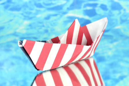 Ship of the American flag, on blue background. Columbus Day. photo