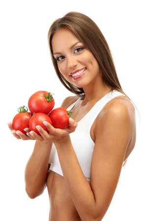 beautiful young woman with tomatoes, isolated on white photo