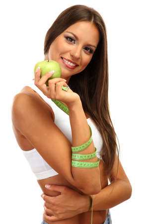 beautiful young woman with green apple and measure tape, isolated on white photo