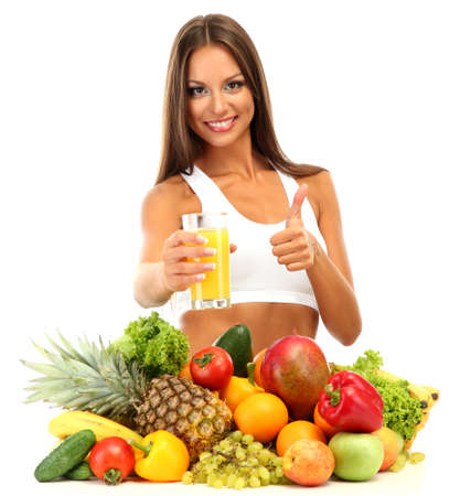 beautiful young woman with fruits and vegetables and glass of juice, isolated on white Stock Photo - 15960247