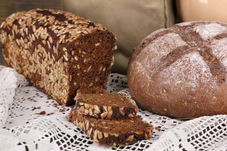 Rye bread on wooden table close-up photo