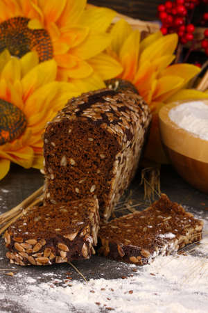 Rye bread on wooden table on wooden background close-up photo