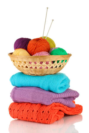 Sweaters and balls of wool isolated on white Stock Photo - 15852060