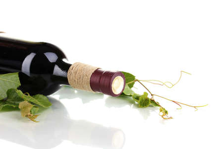 wine  pink: bottle of wine with grape leaves isolated on white