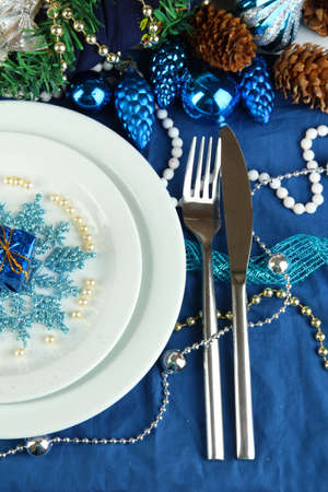 Serving Christmas table in blue tone close-up photo
