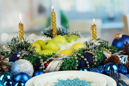 Serving Christmas table in blue tone on room background photo
