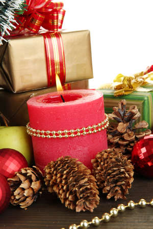 Composition from Christmas decorations close-up on wooden table on white background Stock Photo - 15852214