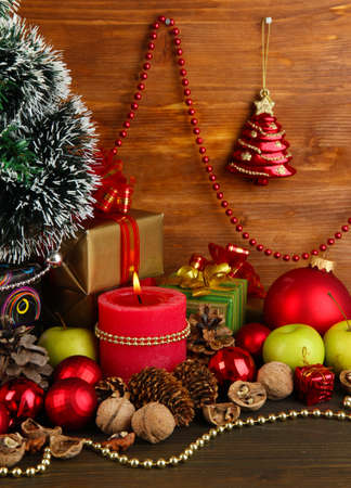 Composition from Christmas decorations on wooden table on wooden background Stock Photo - 15852291