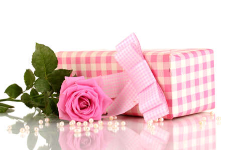 Beautiful pink rose with wonderful gift in pink box isolated on white photo