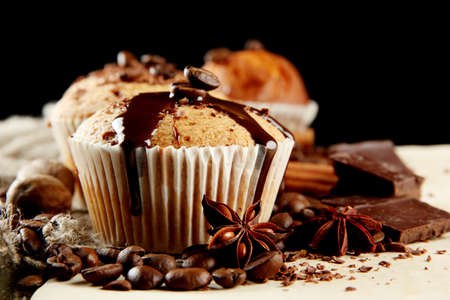 spice cake: tasty muffin cakes with chocolate, spices and coffee seeds, close up