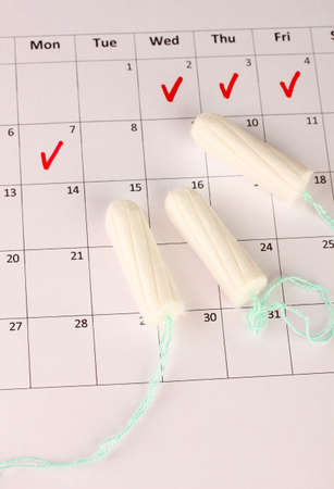 menstruation calendar with cotton tampons, close-up Stock Photo - 15852085