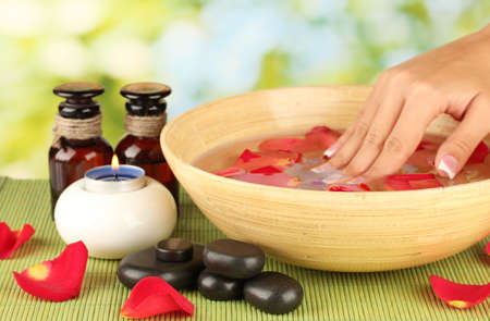 aroma bowl: spa treatments for female hands,  on green background