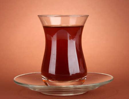 turk: glass of Turkish tea, on brown background Stock Photo