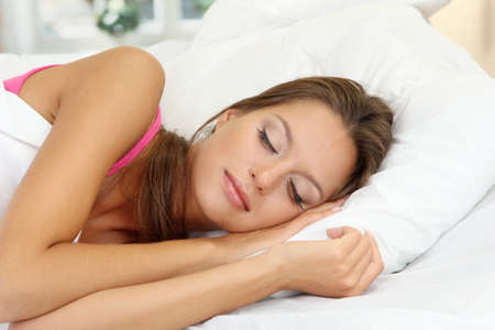 rest: young beautiful woman sleeping in bed