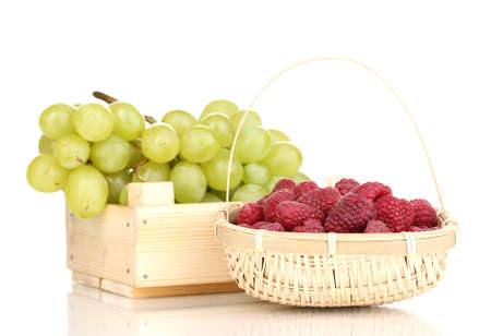 ripe raspberries and grapes isolated on white photo