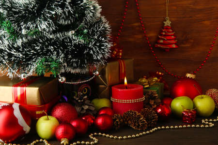 Composition from Christmas decorations on wooden table on wooden background Stock Photo - 15898280