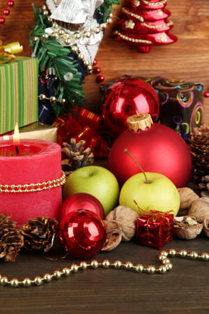 Composition from Christmas decorations close-up on wooden table on wooden background Stock Photo - 15898239