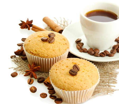 tasty muffin cakes with spices on burlap and cup of coffee, isolated on white photo