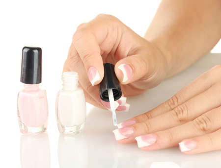 Woman makes herself a French manicure, on white background Stock Photo - 15897634