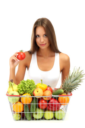 beautiful young woman with fruits and vegetables in shopping basket, isolated on white Stock Photo - 15961492