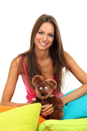 beautiful young girl and fluffy bear with pillows isolated on white Stock Photo - 15961591