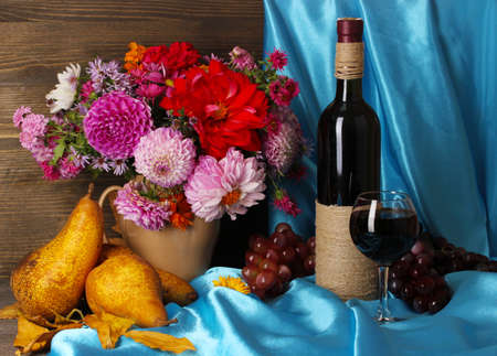 Wonderful autumn still life with fruit and wine photo