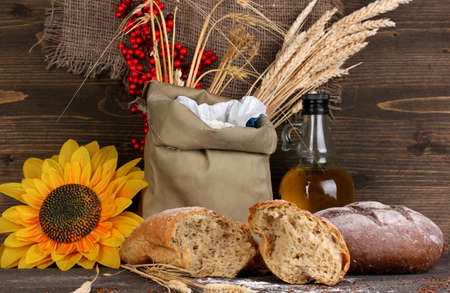 Rye bread on wooden table on wooden background Stock Photo - 15898301