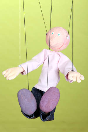 Wooden puppet on green background Stock Photo - 15897962