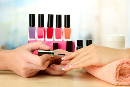 nail care: Manicure process in beauty salon, close up