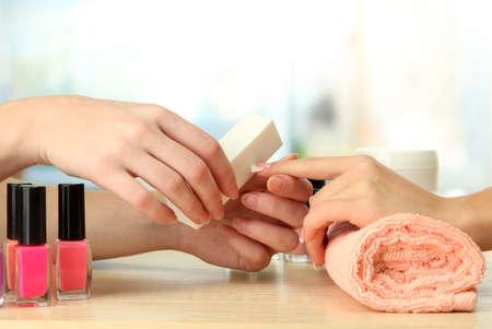 Manicure process in beauty salon, close up photo