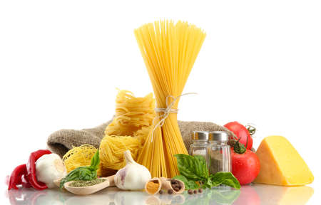 Pasta spaghetti, vegetables and spices, isolated on white Stock Photo - 15931692