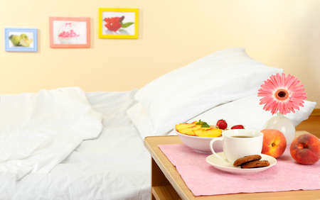 nightstand: light breakfast on the nightstand next to the bed Stock Photo