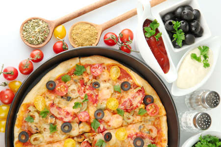 colorful composition of delicious pizza, vegetables and spices on white background close-up Stock Photo - 15924468