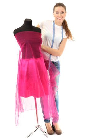 textile designer: beautiful young woman and mannequin isolated on white
