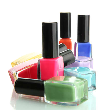 cosmetic products: Group of bright nail polishes isolated on white