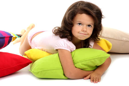 beautiful little girlwith pillows isolated on white Stock Photo - 16346578