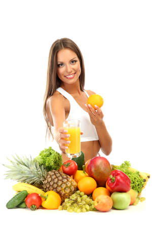 beautiful young woman with fruits and vegetables and glass of juice, isolated on white Stock Photo - 16346626