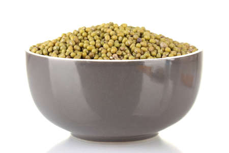 Green mung beans in bowl isolated on white photo
