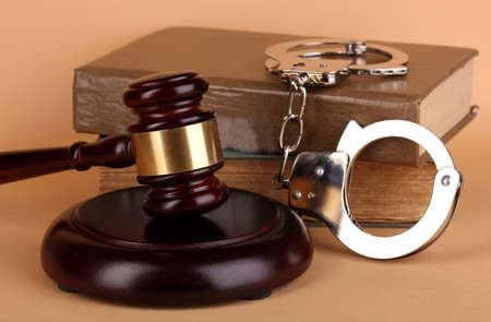 Gavel, handcuffs and book on law on beige background Stock Photo - 15962878