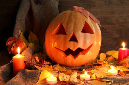 halloween pumpkin and autumn leaves, on wooden background Stock Photo - 15962944