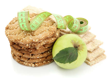 tasty crispbread, apple, measuring tape and ears, isolated on white Stock Photo - 15963948