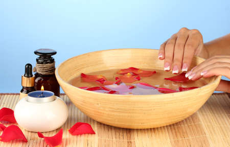 spa treatments for female hands,  on blue background photo