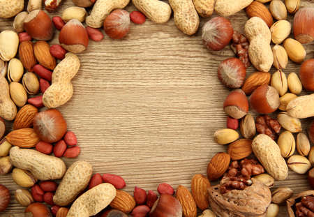cashew nuts: assortment of tasty nuts on wooden background Stock Photo