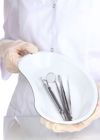 Sterilization tray with dental tools in dentists hands photo