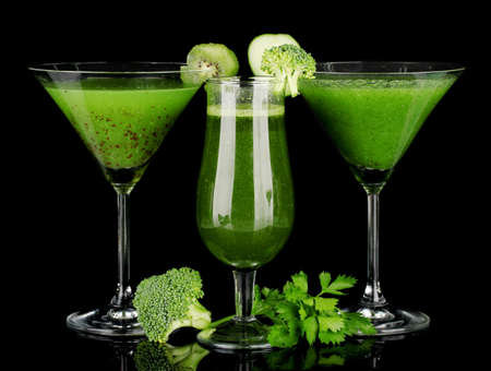 fruit smoothie: Three kinds of green juice in coctail glasses on color background