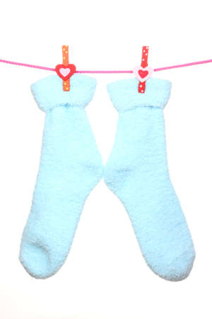 Pair of blue socks hanging on a rope isolated on white Stock Photo - 15963428